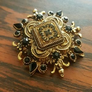 Vintage brooch with black onyx colored stones